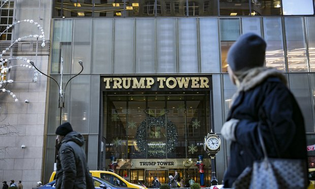Pedestrians pass in front of Trump Tower in New York City
