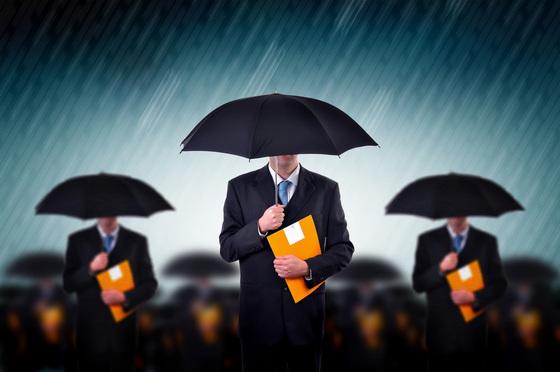 Businessmen with umbrella