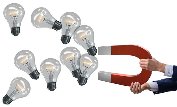 magnet attracting lightbulbs, illustrating deal of copying or plagiarism