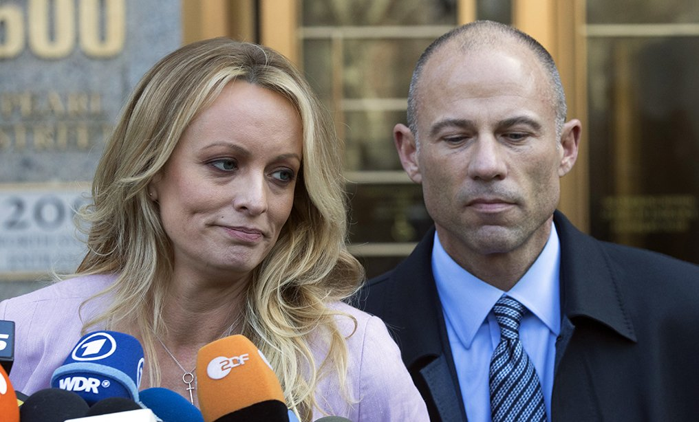 Adult film actress Stormy Daniels stands with her lawyer Michael Avenatti outside federal court in New York last year. Federal prosecutors in New York City say Avenatti used a doctored document to divert about $300,000 that Daniels was supposed to get from a book deal, then used the money for personal and business expenses. (Photo: Mary Altaffer/AP)