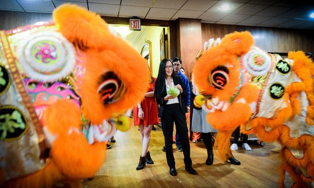 Two lions from the New York Lotus Light Association join United States District Court Judge for the Eastern District of New York Pamela K. Chen, who was honored by the Brooklyn Women's Bar Association and the Asian American Judges Association of New York during an Asian American and Pacific Islander Heritage Celebrationon Monday, May 13, 2019 at the Brooklyn Bar Association in Brooklyn Heights. ...(Photo by David Handschuh/NYLJ)