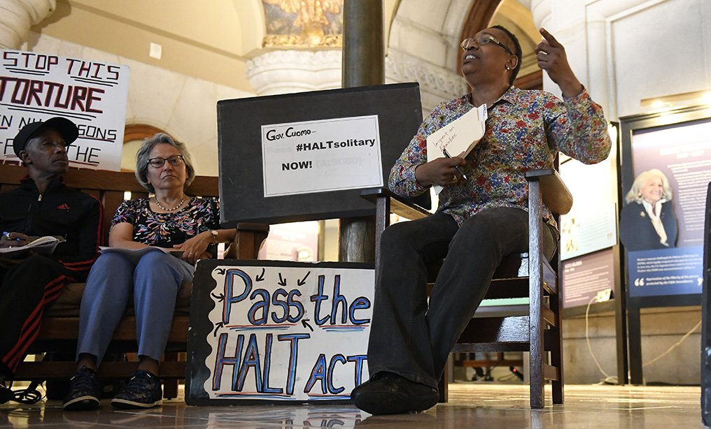 Cynthia Tucker of Manhattan, talks about her son Darryl Tucker who has been held in solitary confinement at New York state correctional facilities, during a rally asking Gov. Andrew Cuomo to stop solitary confinement, at the state Capitol in Albany on Tuesday.