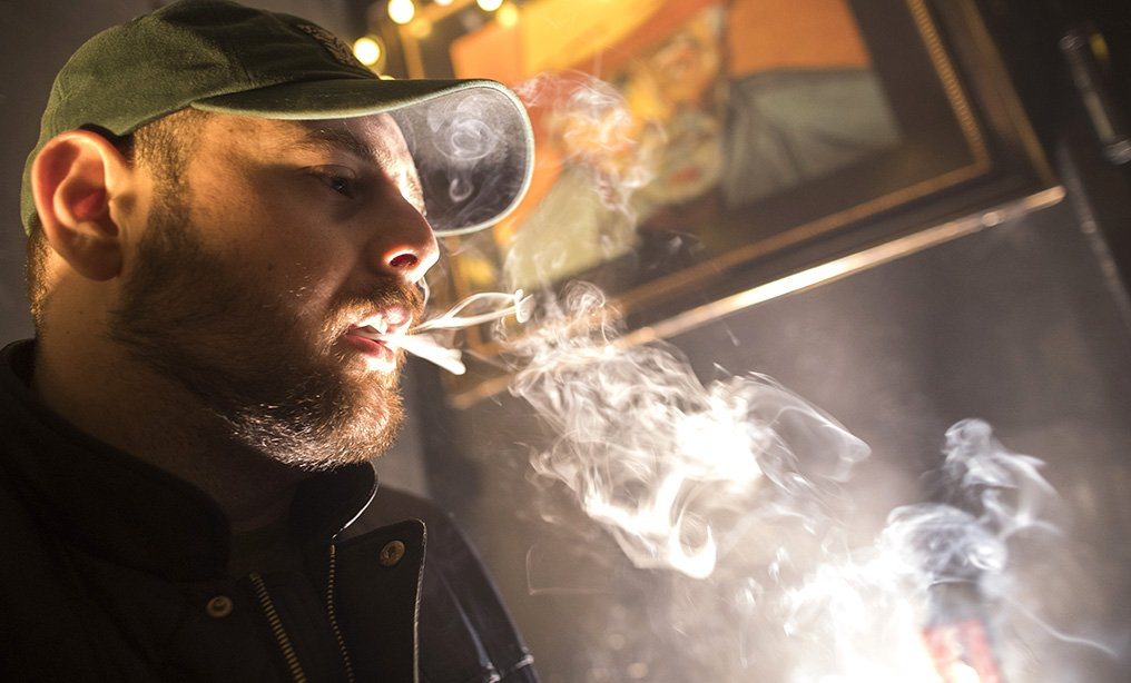 A man smokes marijuana at a Spleef NYC canna-cocktail party in New York. Top lawmakers insist they are still trying to negotiate a compromise that could allow a bill to pass before they adjourn on June 19.
