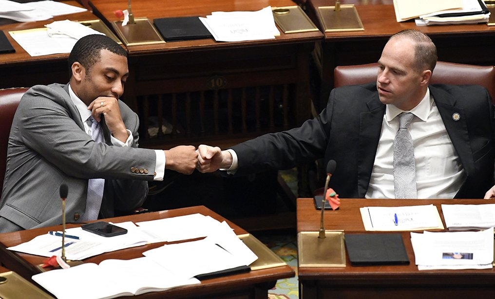 Sen. Jamaal T. Bailey, D-Bronx, left, fist bumps Sen. Timothy M. Kennedy, D-Buffalo, after Bailey's legislation expanding decriminalization legislation for marijuana passed during a legislative session at the state Capitol in Albany on Thursday.