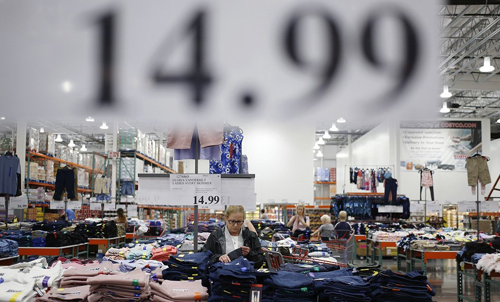 A customer shops for clothes at a Costco Wholesale store. Photo: Luke Sharrett/Bloomberg