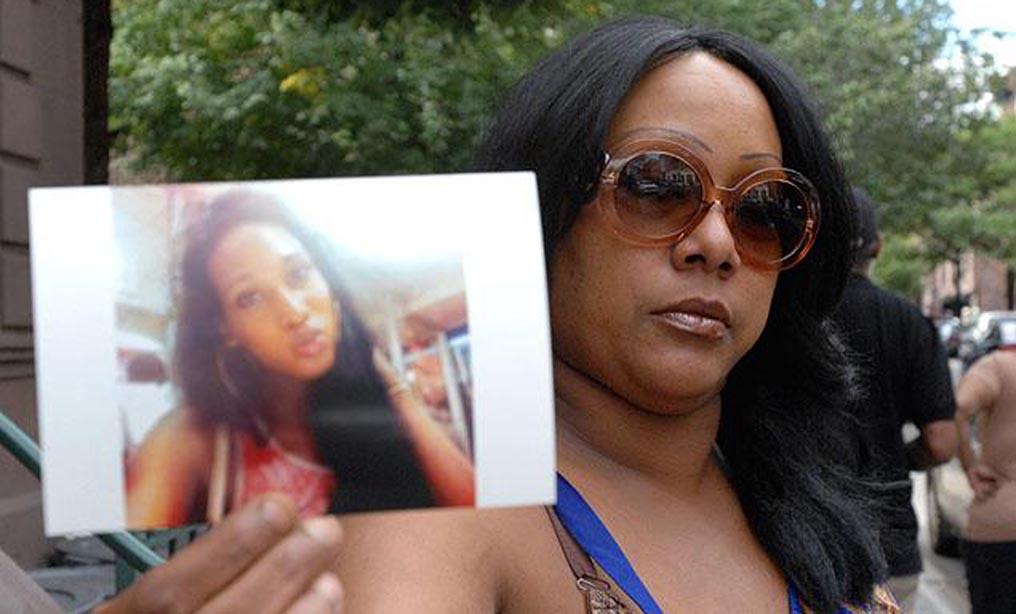 Delores Nettles, the mother of slain transgender woman Islan Nettles, holds up Nettles' picture in 2013.