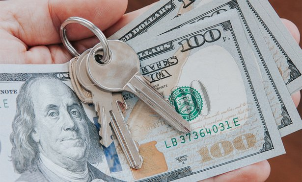 By CatwalkPhotos.Royalty-free stock photo ID: 635556890.Real estate concept, key on a ring and dollars, paying bills, refunding. - Image