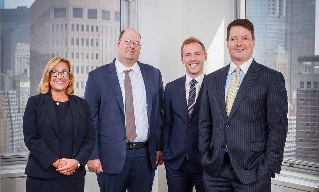 From left, Janice Mac Avoy, partner and co-head of real estate litigation practice, Justin J. Santolli, special counsel; Ben Paull, associate, and Matthew Parrott, partner and co-head of real estate litigation practice (Photo by David Handschuh/NYLJ)
