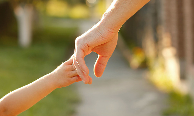Parent Holding Child Hand