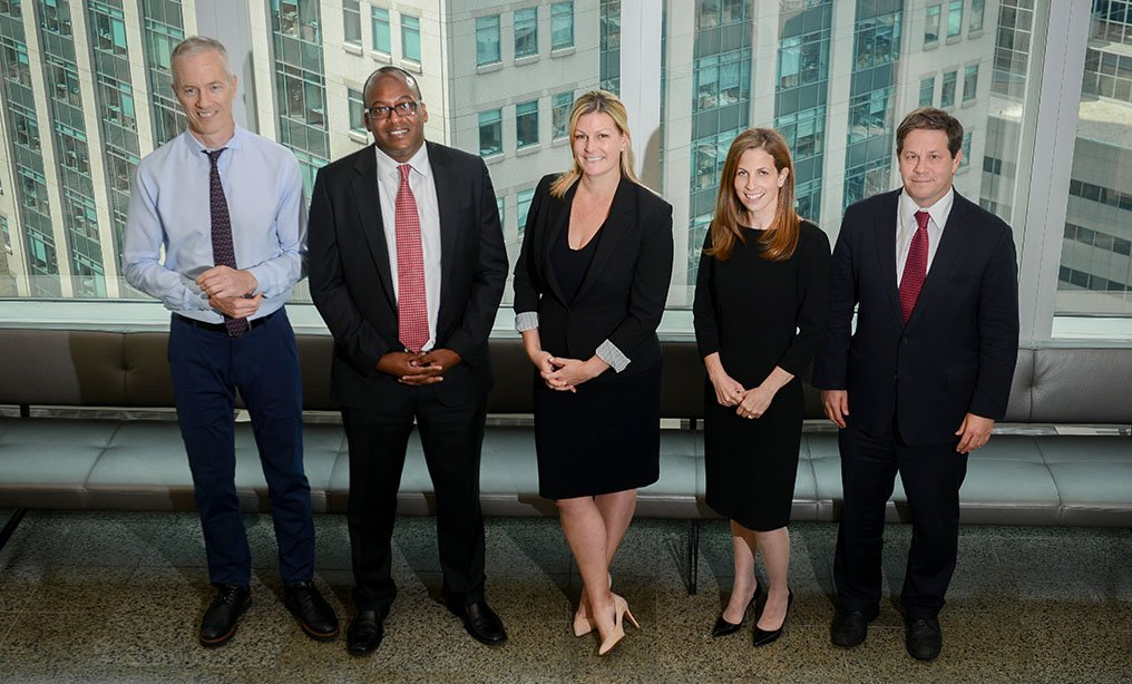 From left, partners Paul Curnin, litigation department co-chair, Linton Mann III, Brooke Cucinella, Susannah Geltman and Jon Youngwood, litigation department co-chair (Photo by David Handschuh/NYLJ)
