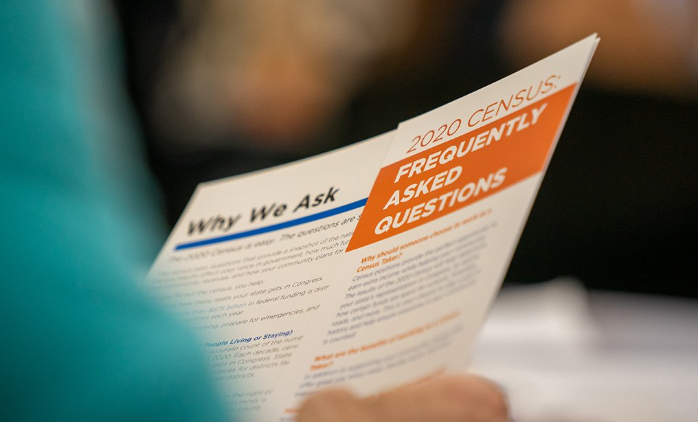 A jobseeker holds an information packet during a U.S. Census Bureau 2020 job opportunities workshop at a senior center on Roosevelt Island in New York, last month.