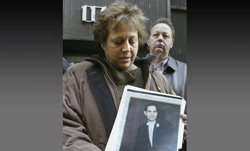 Diane Piagentini, widow of slain police officer Joseph Piagentini, holds a photo of her husband from their wedding day in 1966, after a parole hearing in New York in 2004.