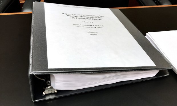 Part of the Mueller Report sits on a congressional desk before the start of a House Intelligence Committee hearing with former special counsel Robert Mueller in Washington, D.C., on Wednesday, July 24, 2019.
