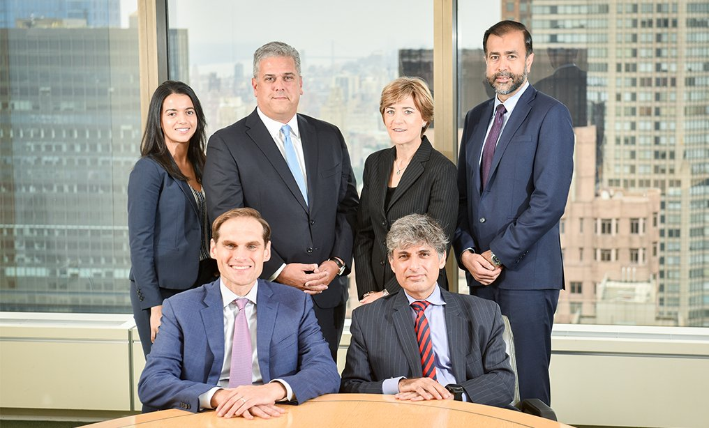 Seated, from left, partners Todd Cosenza and Tariq Mundiya, chair of the litigation department; standing, from left, partners Shaimaa Hussein, Christopher St. Jeanos, Mary Eaton and Sameer Advani