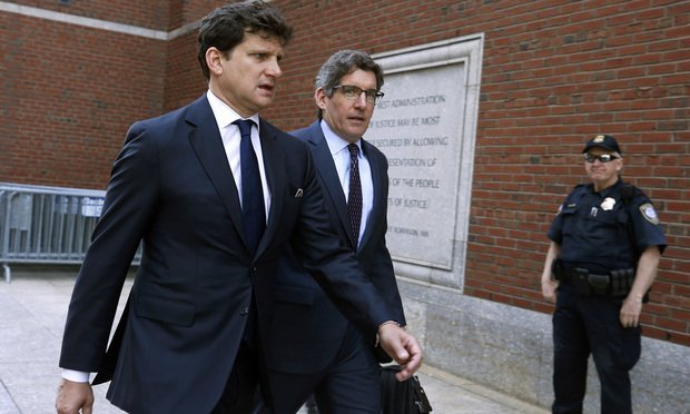 Gordon Caplan, left, arrives at federal court May 21, 2019, in Boston. (AP Photo/Michael Dwyer)