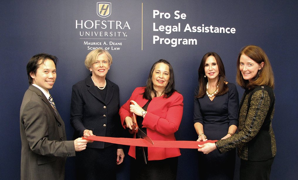 Opening of the Pro Se Legal Assistance Clinic of The Maurice A. Deane School of Law at Hofstra University at the Eastern District of New York's Central Islip courthouse in February. From left, Hofstra Law School staff attorney Ka Fei Wong, Eastern District Judge Joanna Seybert, Chief Judge Dora L. Irizarry of the Eastern District of New York, Judge Gail Prudenti, dean of Hofstra Law and Hofstra Law School professor Jennifer Gundlach. Photo: Hofstra Law/Facebook