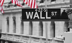 Fired Exec at Wall Street Investment Firm Claims She Was Unfairly Labeled 'Aggressive'