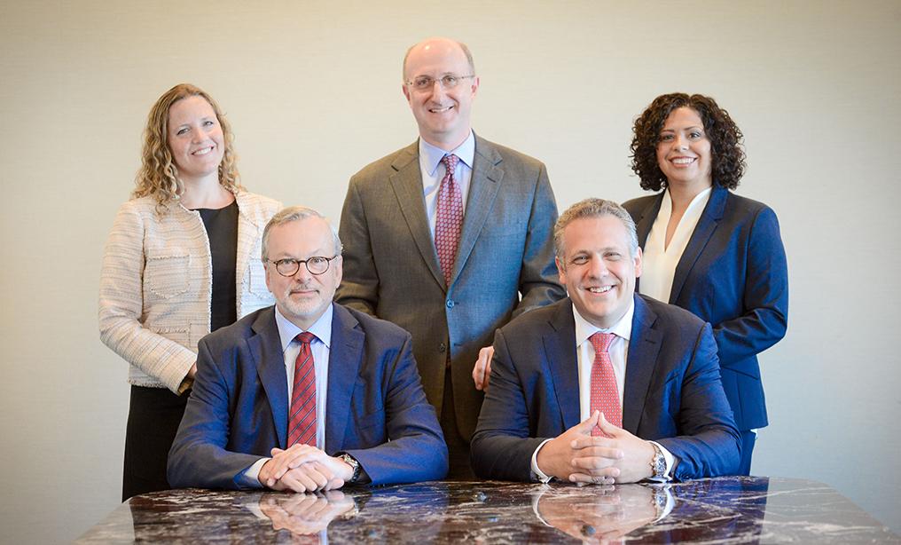 Seated, from left, litigation partners Peter Barbur, and Kevin Orsini; standing, from left, litigation partners Rory Leraris, Daniel Slifkin, head of litigation, and Damaris Hernández