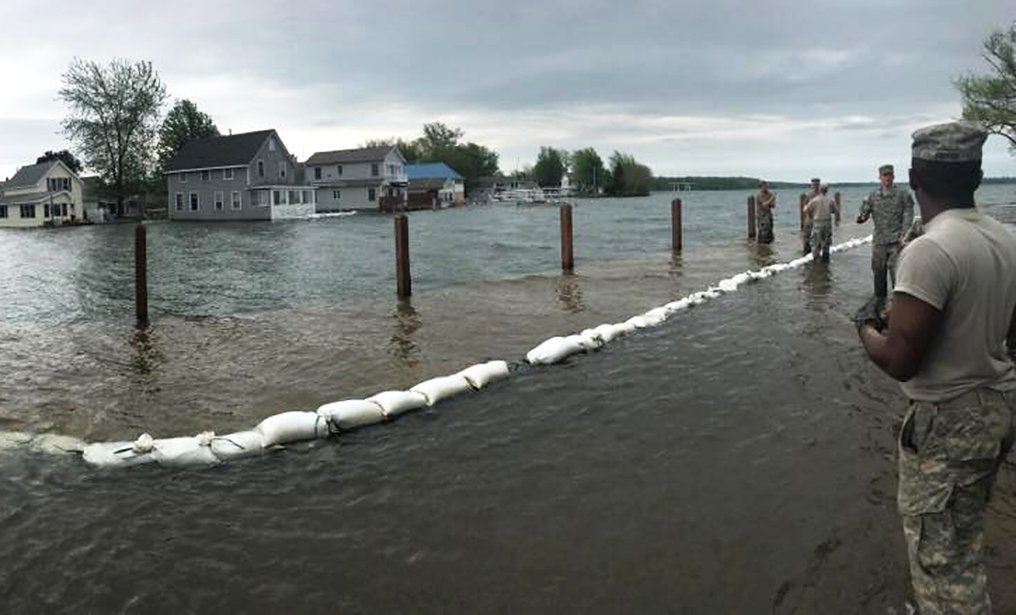 Soldiers of the New York Army National Guard's 105th Military Police Company construct a sandbag barrier to protect property at Sodus Point, N.Y. from flooding due to rising waters on Lake Ontario on May 22, 2017. New York Army and Air National Guard members have been on duty since May 3 assisting in preventing flooding at the order of New York Gov. Andrew N. Cuomo. ( U.S. Army Natonal Guard Photos by Sgt. 1st Class Patrick Belmont.)