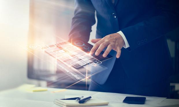 Businessman using tablet for digital marketing.