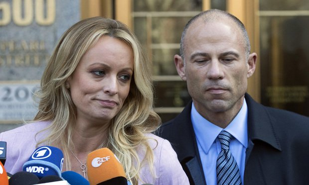 In this April 16, 2018 file photo, adult film actress Stormy Daniels, left, stands with her lawyer Michael Avenatti as she speaks outside federal court, in New York. Avenatti, the attorney who rocketed to fame through his representation of Daniels in her battles with President Donald Trump, was charged Wednesday, May 22, 2019, with ripping her off. Federal prosecutors in New York City say Avenatti used a doctored document to divert about $300,000 that Daniels was supposed to get from a book deal, then used the money for personal and business expenses. (AP Photo/Mary Altaffer, File)