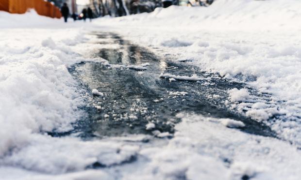 Icey sidewalk/credit: kolt_duo/Shutterstock.com