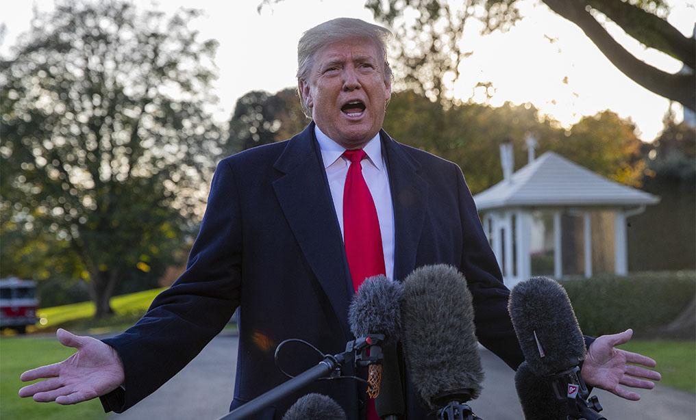 President Donald Trump talks to media on the South Lawn of the White House in Washington, on Monday, Nov. 4. Photo: Patrick Semansky/AP