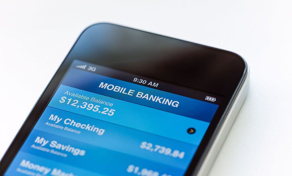 Mobile phone with mobile banking application on a screen.