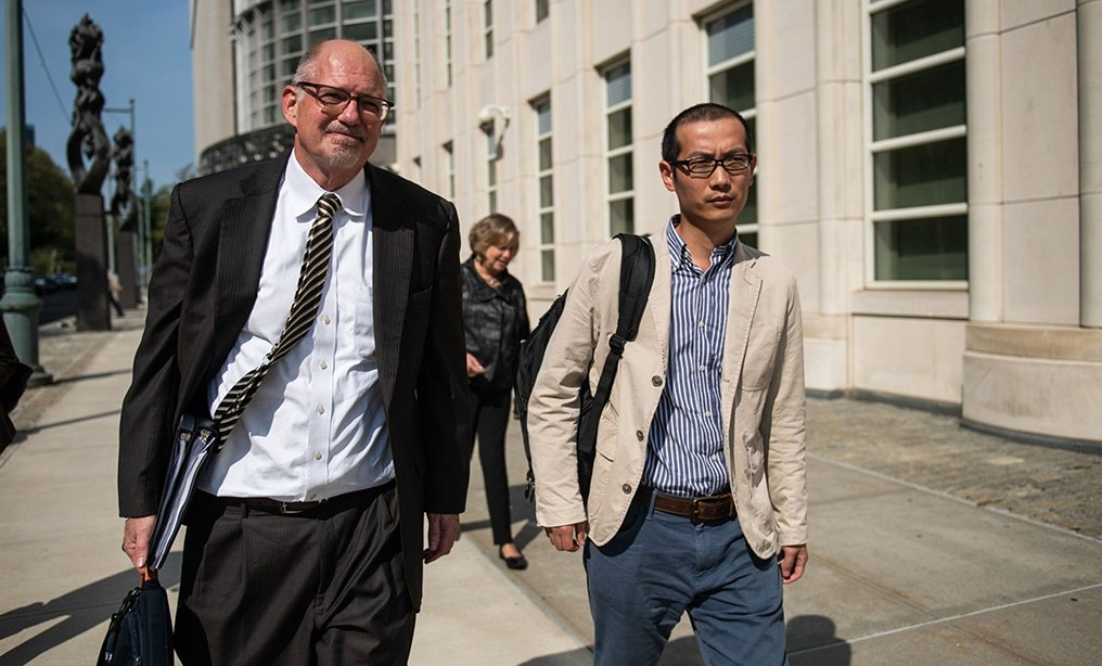 Professor Bo Mao, right, departs Eastern District courthouse in September, with his attorney Richard Roper of Thompson & Knight. Photo: Mark Kauzlarich/Bloomberg