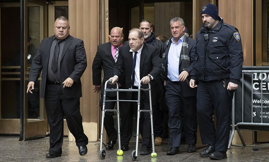 Harvey Weinstein, center, leaves court following a hearing in Manhattan on Wednesday, Dec. 11.