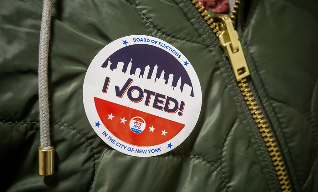 """A voter wears her """"I Voted"""" sticker on Election Day in New York. Photo: Shutterstock"""