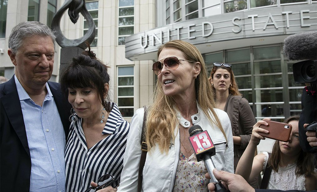Toni Natalie, second from left, and Catherine Oxenberg talk with the media outside Brooklyn federal court last year, after NXIVM's leader Keith Raniere was found guilty on all counts. Natalie is a former member of NXIVM and one the plaintiffs named in the suit filed on Tuesday. Oxenberg's daughter was a member of NXIVM. Photo: Mark Lennihan/AP