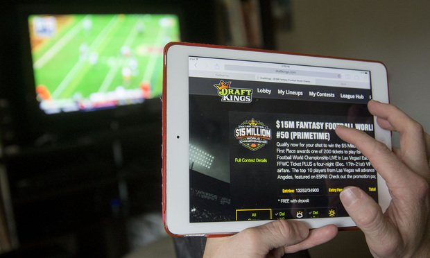 The DraftKings Inc. website is arranged for a photograph on an Apple Inc. iPad in Washington, D.C., U.S., on Sunday, Oct. 4, 2015. Fantasy sports companies DraftKings Inc. and FanDuel Inc. raised a total of $575 million in July from investors including KKR & Co., 21st Century Fox Inc. and Major League Baseball to attract players to games that pay out millions of dollars in cash prizes in daily contests. Photo: Zia Morales/Bloomberg