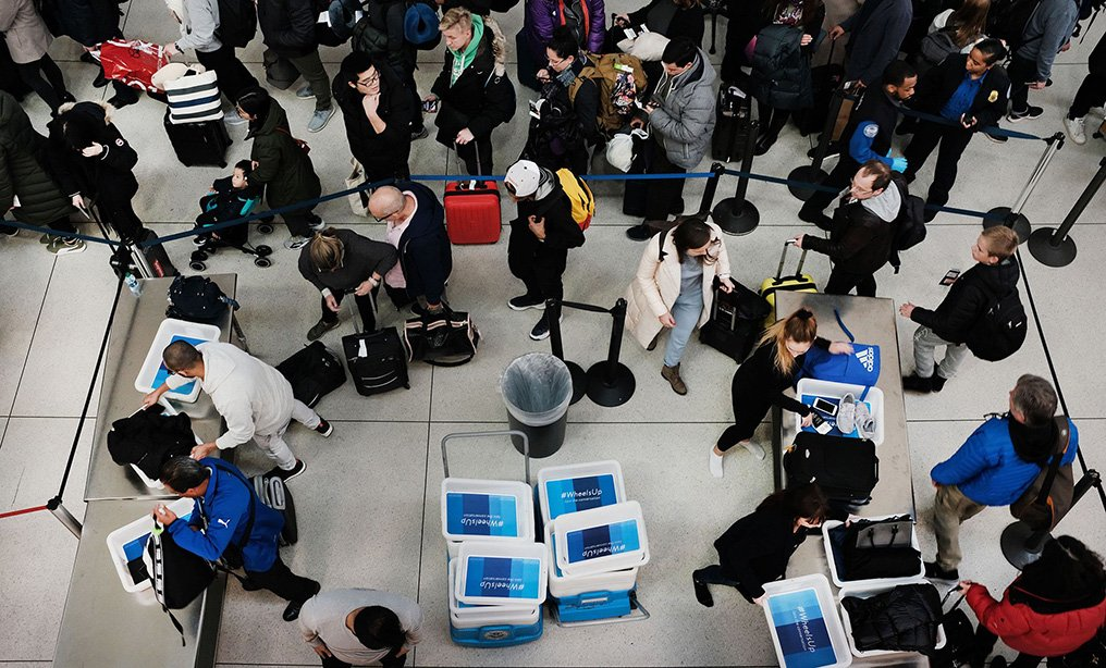Passengers wait in a line at JFK airport in New York earlier this year. Photo: Spencer Platt/Getty Images