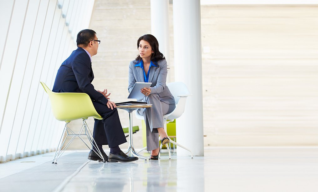 Businessman And Businesswoman Meeting In Modern Office By Monkey Business Images/Shutterstock