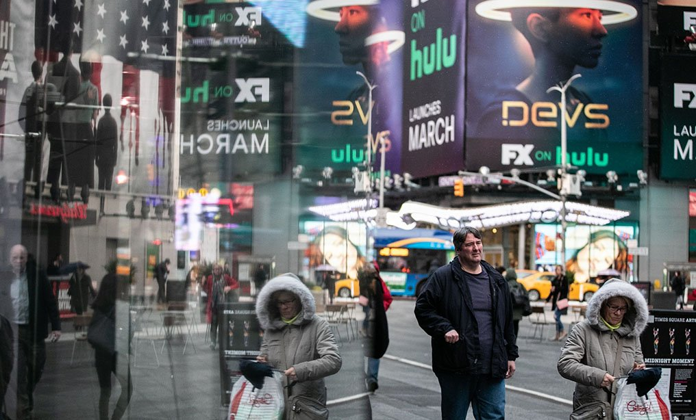 Pedestrians walk through the Time Square in New York, on Tuesday, March 3. New York has confirmed its second case of the coronavirus, as the number of nationwide cases surpassed 100. Photo: Jeenah Moon/Bloomberg