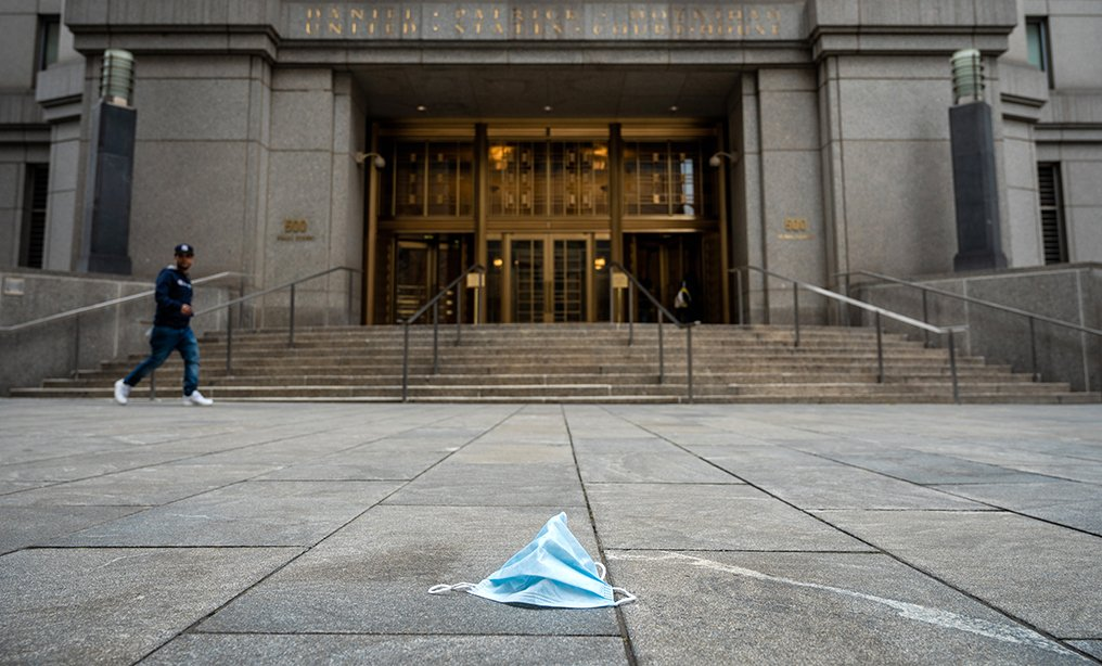 Discarded surgical mask in front of the Southern District courthouse in Manhattan. Both Southern and Eastern District courts barred people who have traveled to China, South Korea, Japan, Italy and Iran in the past 14 days. Photo: Ryland West