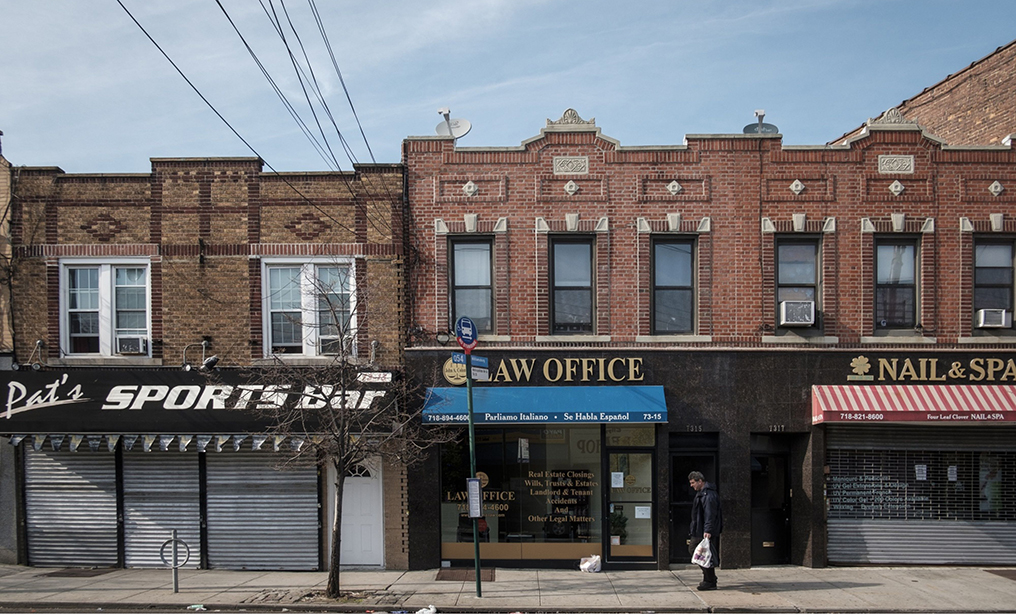 A law office and other closed businesses on Metropolitan Ave. in the Queens borough of New York early this month