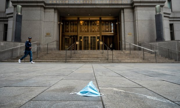 Discarded surgical mask in front of the Southern District courthouse in Manhattan.
