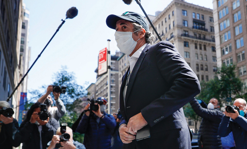 Michael Cohen arrives at his Manhattan apartment, Thursday, May 21, 2020, in New York. Cohen has been serving a federal prison sentence at FCI Otisville in New York after pleading guilty to numerous charges, including campaign finance fraud and lying to Congress. (AP Photo/John Minchillo)