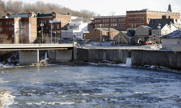 In this Jan. 21, 2016, file photo, the Hoosic River runs through the village of Hoosick Falls, New York. No higher incidences of certain types of cancer linked to the toxic chemical PFOA were found in the upstate New York village whose water supplies were contaminated by the chemical, state health officials said in a report released Wednesday, June 7, 2017. (AP Photo/Mike Groll, File)