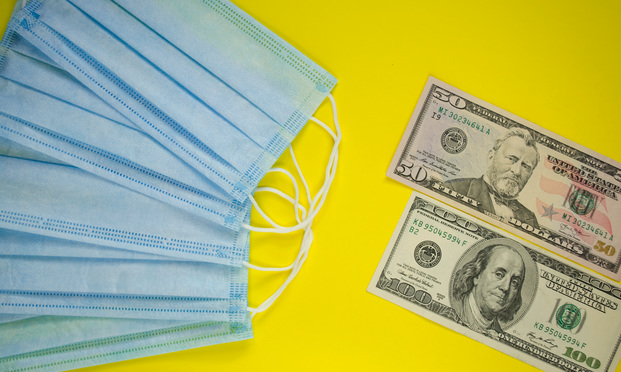 Medical masks with dollars. Photo: Shutterstock