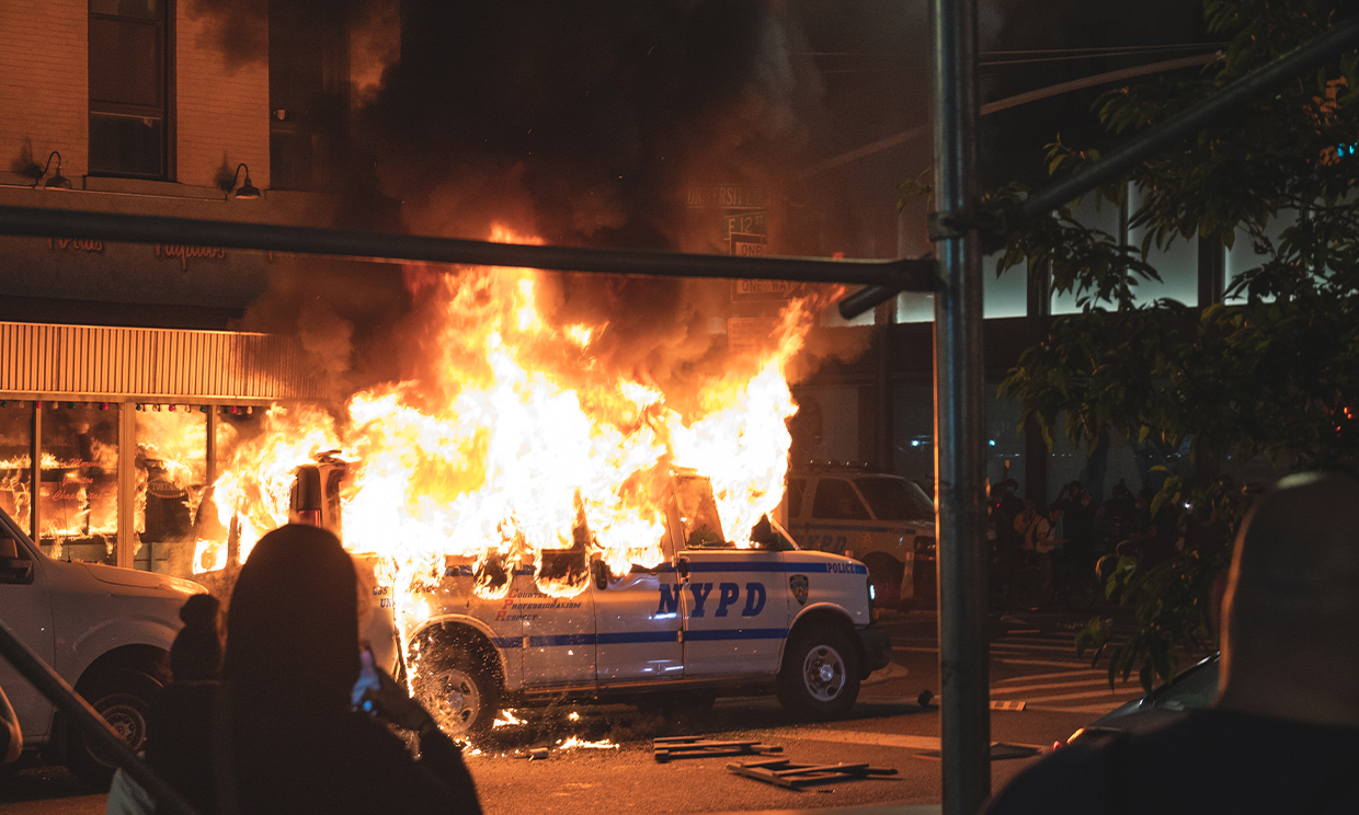 May 20, 2020 Protestors set fire to an NYPD Van after a peaceful protest turned into a violent uprising. Photo: Ryland West/ ALM