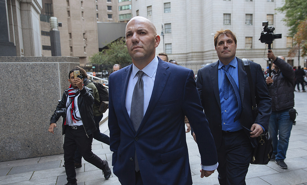 David Correia, center, leaves federal court in Manhattan last year. Photo: Kevin Hagen/AP