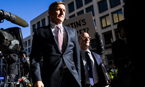 Retired Army Lt. Gen. Michael Flynn, center, arrives for sentencing at federal court in Washington, with attorney Robert Kelner, right, on Tuesday, December 18, 2018. General Flynn pleaded guilty to lying to the FBI during the course of special counsel Robert Mueller's investigation into possible collusion between the Trump Campaign and the Russian government.