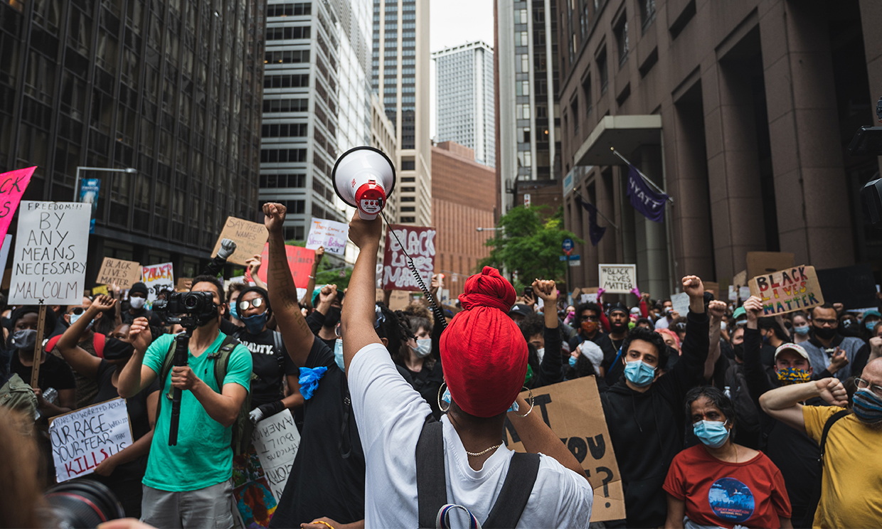 A woman leading a protest for Black Lives Matter and the death of George Floyd