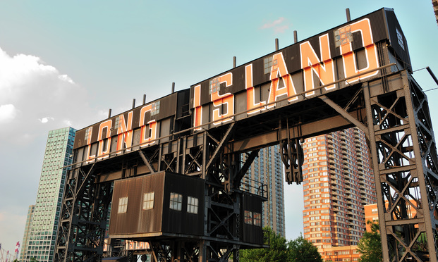 "Modern pier with ""Long Island"" painted on it in Gantry Plaza State Park Queens, New York."