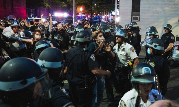 The NYPD break up a protest after curfew. Photo: Ryland West/ ALM