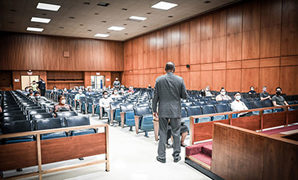 Administrative Judge Norman St. George greets prospective grand jurors last month, for the first time in nearly four months, as courts outside of New York City continue to gradually increase in-person operations. Photo: Courtesy of NY Courts