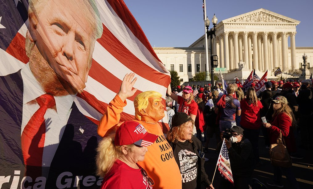 Supporters of President Donald Trump march outside the Supreme Court building in Washington on Nov. 14. Photo: Jacquelyn Martin/AP